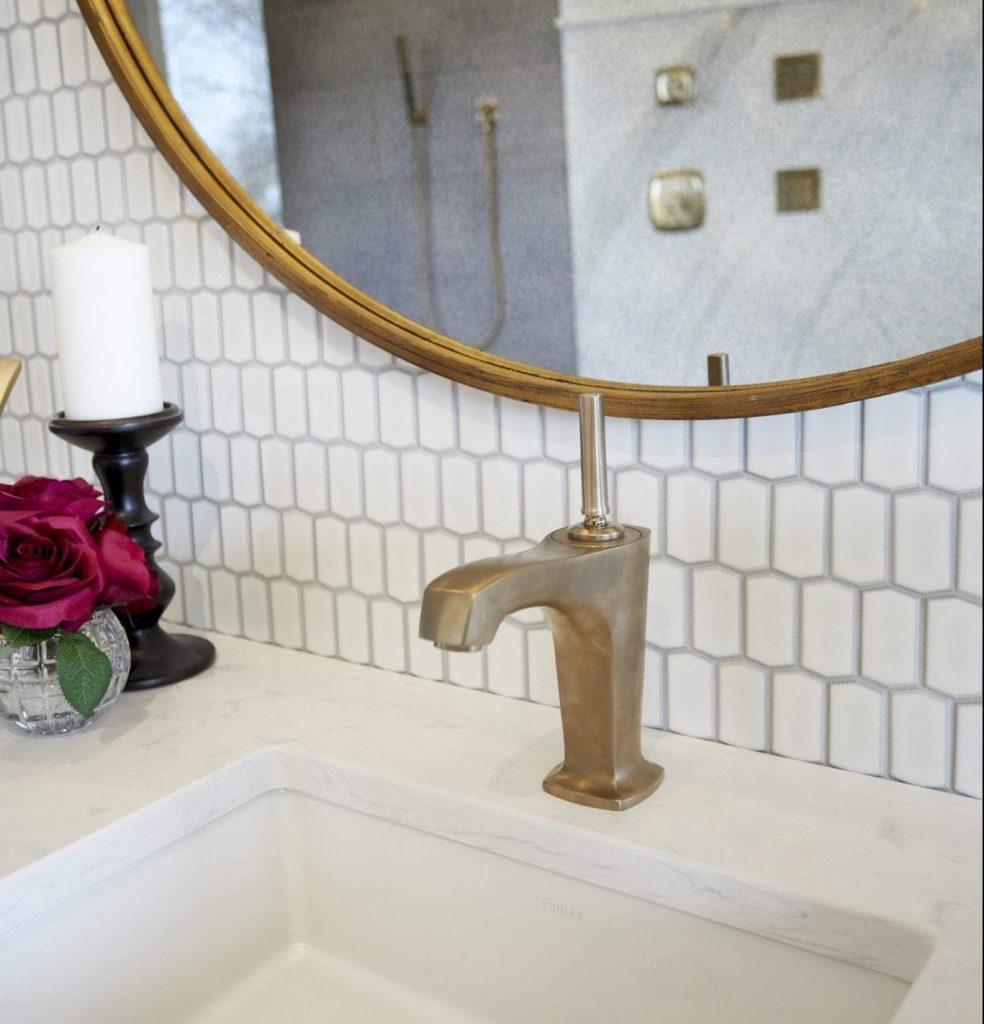 Gold sink fixtures in bathroom renovation