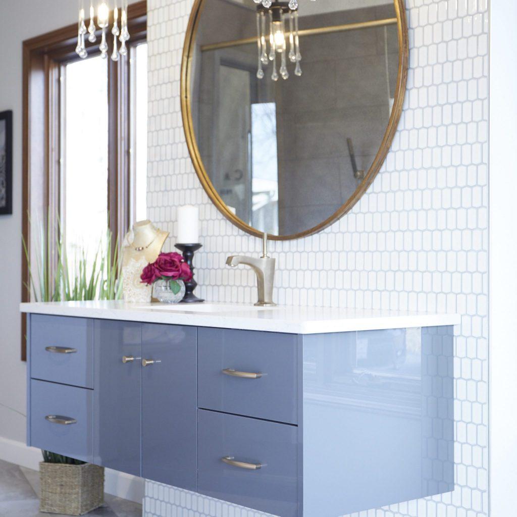 Floating bathroom vanity with circular mirror