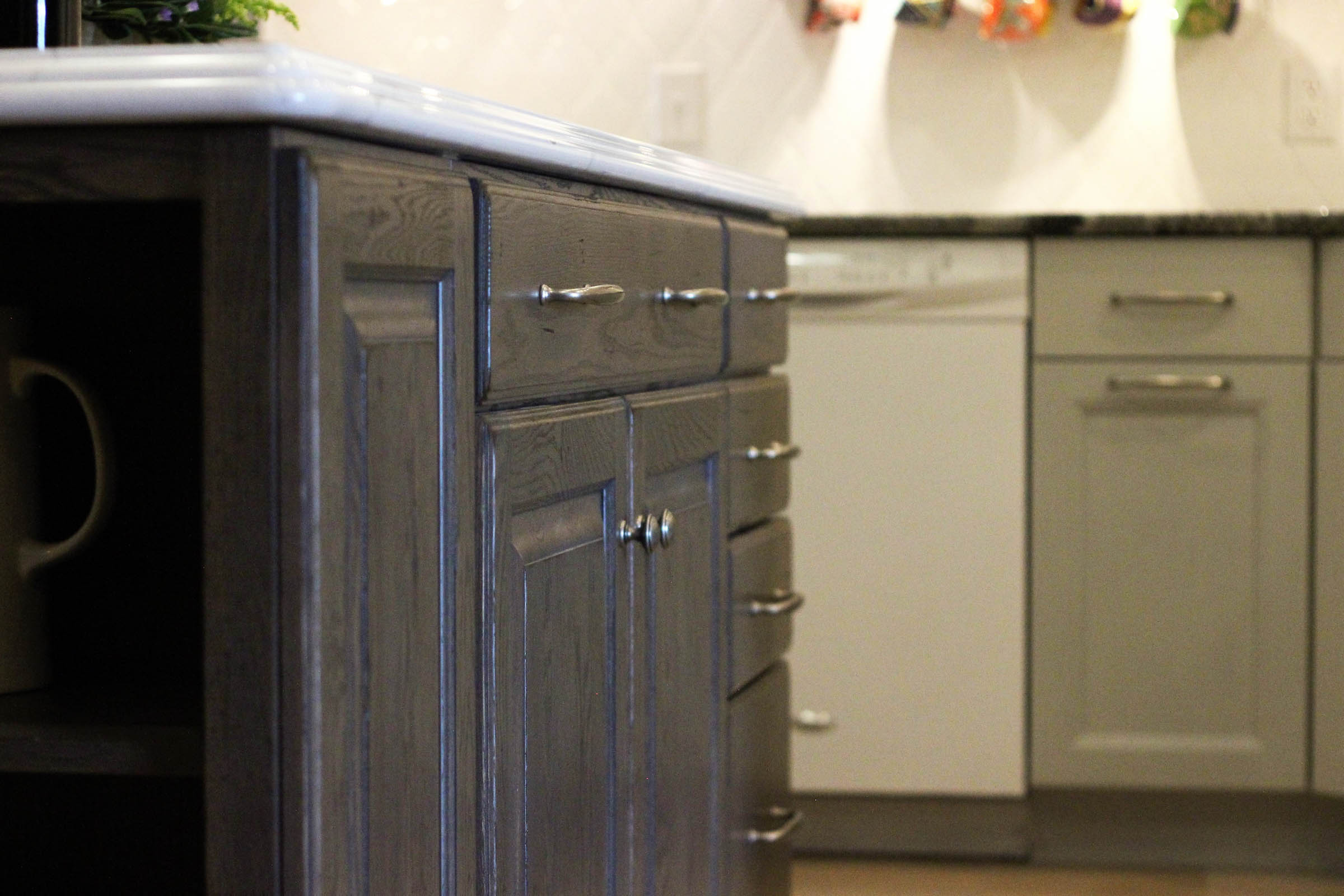 Side view of gray stained cabinets in showroom